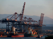 Container Terminal. And Cargo vessel at sunset Stock Photo