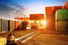 The container terminal at dusk. When the container terminal at dusk, work cranes and forklift Royalty Free Stock Image
