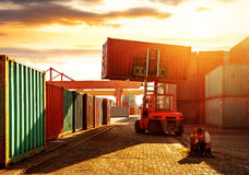 The container terminal at dusk. When the container terminal at dusk, work cranes and forklift Royalty Free Stock Photography