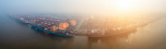Container terminal in morning fog. Port of shanghai yangshan panorama in morning fog, aerial view of China`s largest container terminal Stock Photography