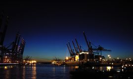 Container terminal at night. Busy container port at night Stock Images
