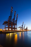 Container Terminal at Night. A large container harbor with deep blue night sky, taken with a shift lens Royalty Free Stock Photos