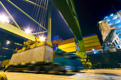 Container terminal by night operations stock photos