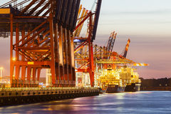 Container Terminal at Night. Container ship at a terminal at duskn Royalty Free Stock Images