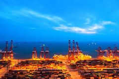 Container terminal at nightfall Royalty Free Stock Images