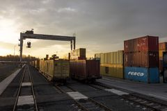 Container terminal for unloading goods from trains to trucks Royalty Free Stock Image