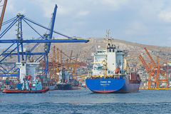 Container terminal. View of a cargo vessel during the entry process at the container terminal of Cosco company at Keratsini (Piraeus - Greece). The container Stock Image