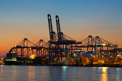 Container terminal. View of a container terminal at night stock photography