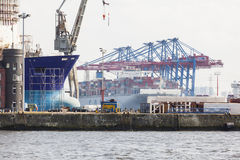 Container Terminals in Hamburg, Germany, editorial. Hamburg, Germany - july 5: Giant ship in container harbor with tall cranes in Hamburg Harbor, Germany on july Royalty Free Stock Photo