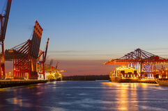 Container Terminals at Night. A large container harbor with colorful evening sky Stock Images