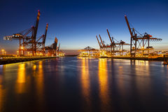 Container Terminals at Night. A large container harbor with deep blue night sky Stock Images