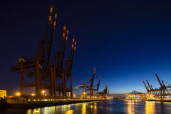Container Terminals at Night. A large container harbor with deep blue night sky, taken with a shift lens Stock Images
