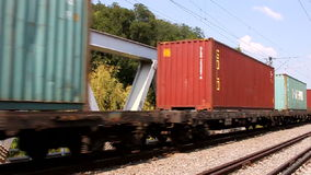 Container train. Passing a bridge stock video footage