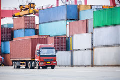 Container transport area. A cargo containers truck with industrial crane loading Royalty Free Stock Image