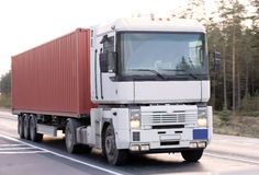 Container truck. Bright red container truck on road, of my business vehicles series Royalty Free Stock Photo
