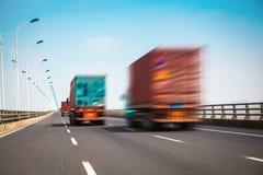 Container truck on the cross-sea bridge Stock Photo