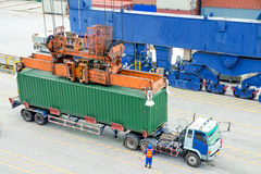 Container truck waiting for loading container box to Cargo ship Royalty Free Stock Photos