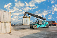 Container unloading truck in logistics yard., Business transportation. Stock Photo