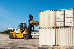Container unloading truck in logistics yard., Business transportation. Royalty Free Stock Photo