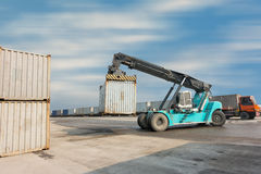 Container unloading truck in logistics yard., Business transportation. Stock Photography