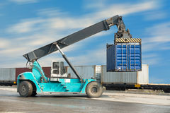 Container unloading truck in logistics yard., Business transportation. Royalty Free Stock Images