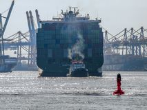 Ship arriving in the Port of Hamburg. Container vessel `Ever Charming` of Evergreen berthing in the Port of Hamburg stock image