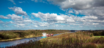Container vessel on Kiel Canal, Germany.  Royalty Free Stock Images