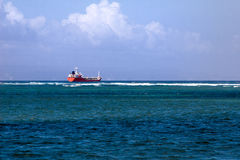 Container Vessel on the ocean Stock Photo