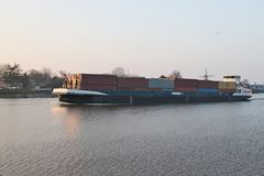 Container vessel on River Hollandse IJssen in Capelle aan den IJssel in Netherlands royalty free stock photo