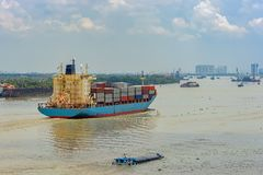 Container vessel sails upstream the Song Long River. Container vessel sails upstream the Song Long River from Vung Tau bay to Ho Chi Minh City. Vietnam stock images
