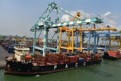 Container vessel at the terminal stock image