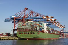 Container vessel at terminal in port Stock Photo