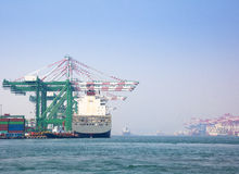 Container vessel unloaded in Port of kaohsiung Royalty Free Stock Image