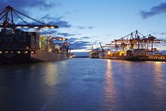Container vessels at Hamburg harbour. The container vessels Zim Rotterdam (left side) and Dublin Express (right side) are loaded/unloaded at container terminals royalty free stock photos