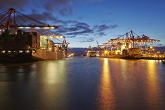 Container vessels at Hamburg harbour. The container vessels Zim Rotterdam (left side) and Dublin Express (right side) are loaded/unloaded at container terminals royalty free stock images