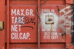 Container weights and dimensions indications. Red container weights and dimensions indications with graffitis royalty free stock photos
