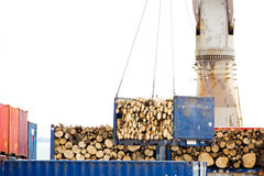 Container witg wood being lifted by a crane Stock Photo