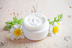 Container With Cream And Chamomiles Royalty Free Stock Photos