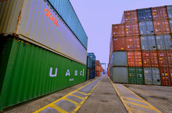 Container yard in Xiamen harbor, Fujian, China. Xiamen container yard, in Fujian province, China, shown as working and operations in cargo area, and industrial Royalty Free Stock Image