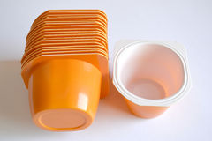 Container of yogurt. A few orange plastic containers for yogurt Royalty Free Stock Images