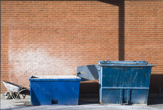 Containers. Two Containers and a wheelbarrow stock images