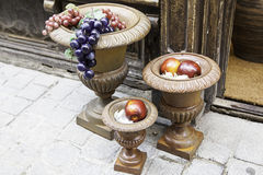 Containers with apples and grapes Royalty Free Stock Image