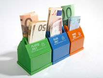 Containers with banknotes. Stock Images
