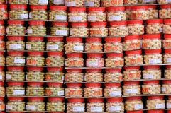 Containers Of Chinese Cookies. Red containers of Chinese Cookies sold during the festive Lunar New Year. The large Chinese character on the container means Royalty Free Stock Photos