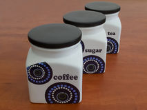 Containers of coffee, sugar and tea Royalty Free Stock Photo