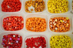 Containers with colored glass elements for mosaic. Yellow, red, orange. Creativity. art . royalty free stock photos