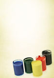 Containers with colorful paint Stock Photography