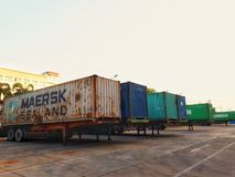Containers. Container the goods into the containers.By carrying container trailers to the harbor for transportation Stock Image