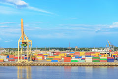 Containers and crane in cargo port Royalty Free Stock Photo
