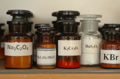 Containers with different chemicals in a laboratory Royalty Free Stock Images